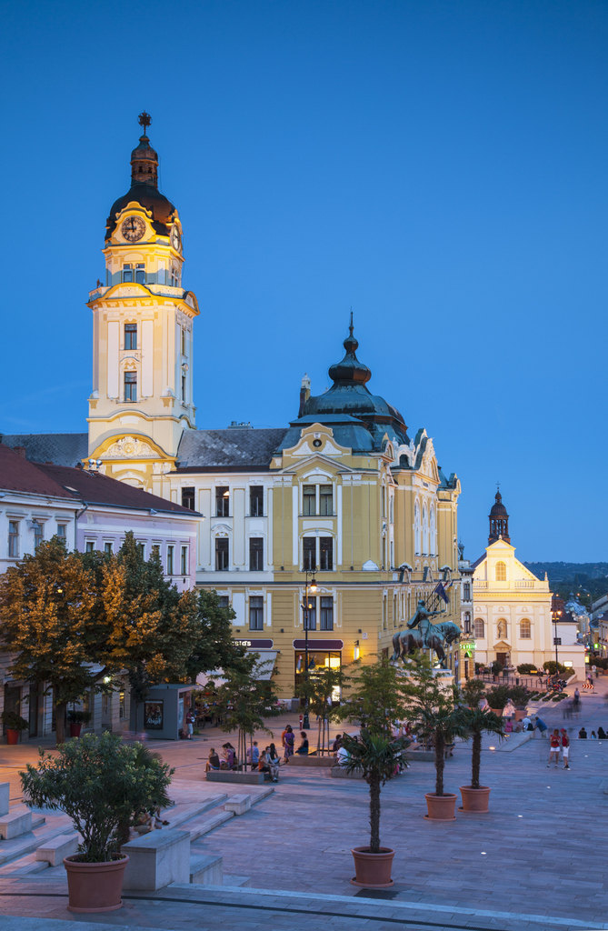 Hungary, Southern Transdanubia, Pecs, Town Hall in Szechenyi Square at dusk